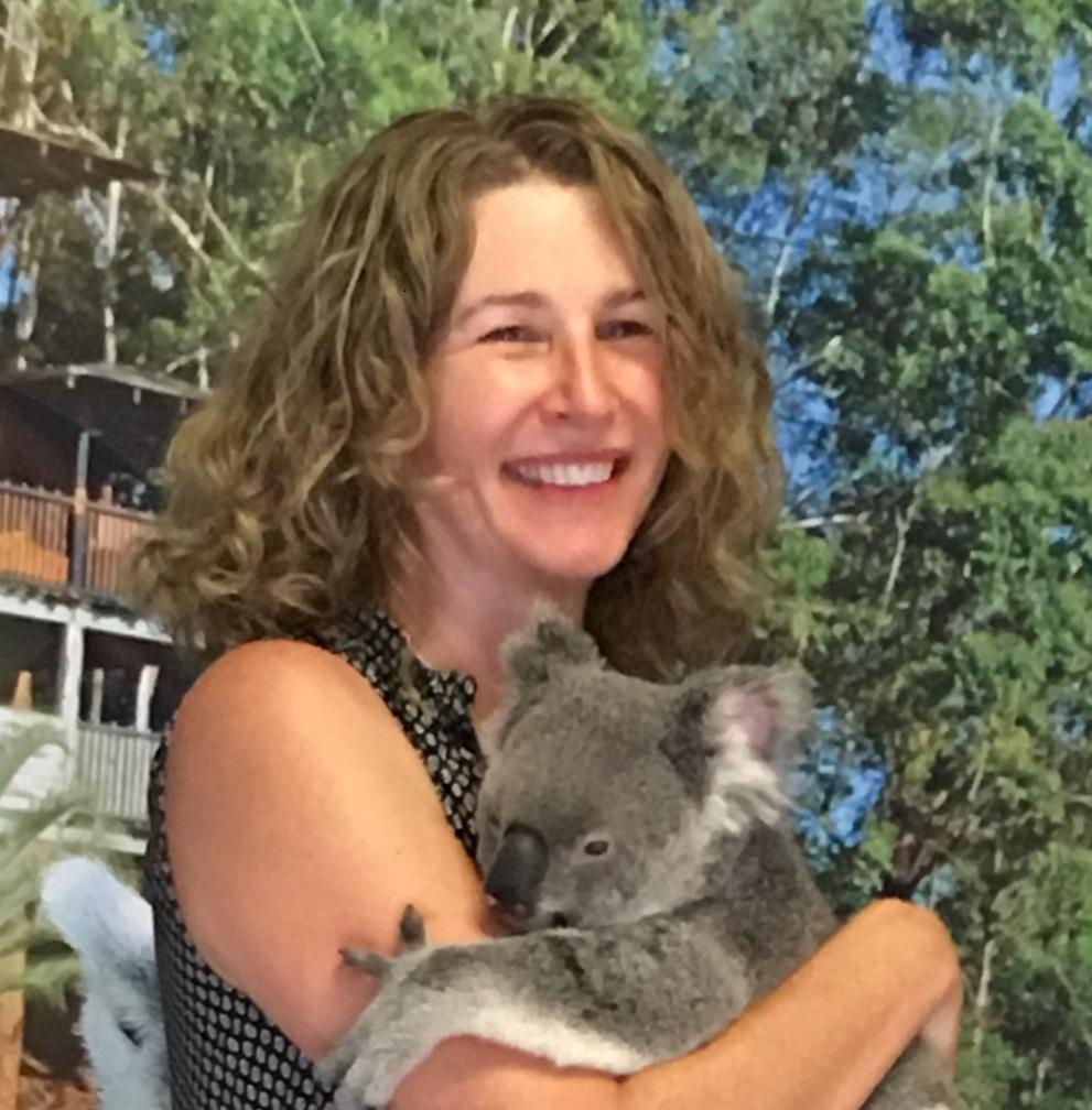 Dr. Nichole Fairbrother holding a koala bear