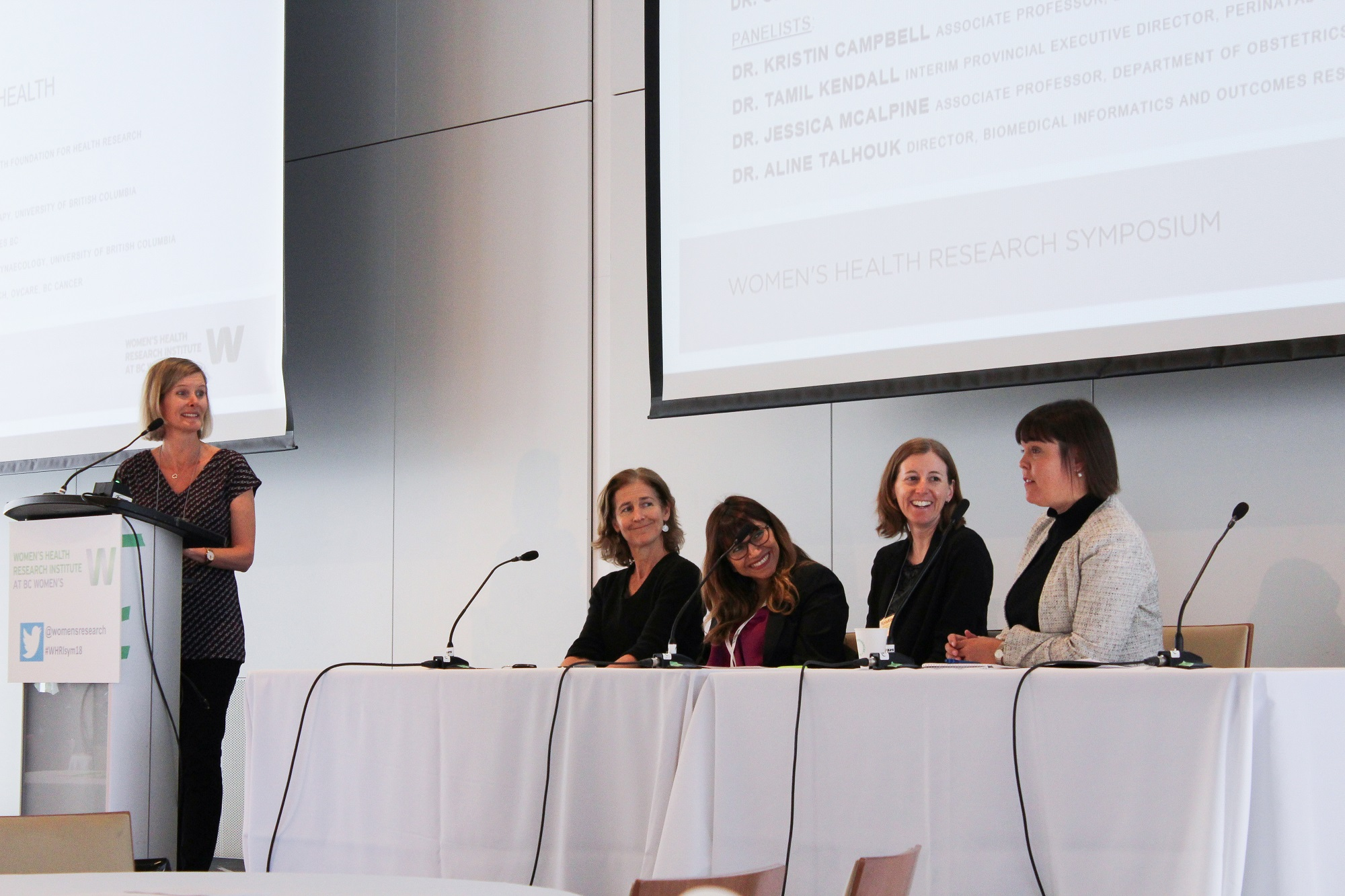 Drs. Genevieve Creighton, Jessica McAlpine, Aline Talhouk, Kristin Campbell, and Tamil Kendall talking during a facilitated panel discussion